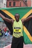 Parafuso de Usain com bandeira. Imagem de Stock Royalty Free