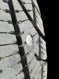 Parafuso no pneu Imagem de Stock