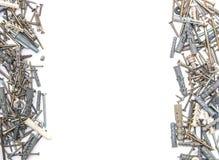 Parafusos com os passadores plásticos isolados Fotos de Stock Royalty Free