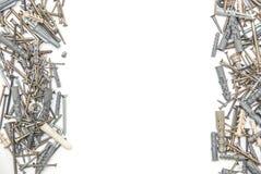 Parafusos com os passadores plásticos isolados Fotos de Stock