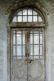 Parafusos com a porta de madeira do vintage Fotos de Stock