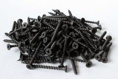 Parafusos de aço pretos para a madeira no branco Foto de Stock Royalty Free