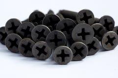 Parafusos pretos para o uso do metal fotografia de stock royalty free