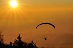 Paraglaiding at sunset Stock Photos