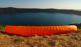 Paraglide. Orange paraglide ready to launch Stock Photo
