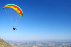 Paraglide. Colorful paraglide on blue sky Stock Photography