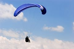 Paraglide. R in blue sky stock images