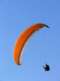 Paraglide on a clear sky. Paraglide (parachute) flying under a clear blue sky Royalty Free Stock Photography