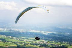 Paraglide Over Fields stock images