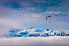 Paraglide over snow-capped peaks Royalty Free Stock Photography