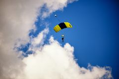 Paraglide silhouette on daylight skyes Royalty Free Stock Image