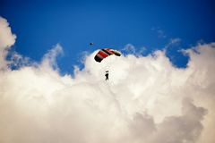 Paraglide silhouette on daylight skyes Stock Photos