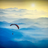 Paraglide silhouette in a light of sunrise Royalty Free Stock Images