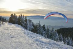 Paraglide silhouette. Over mountain peaks Royalty Free Stock Image