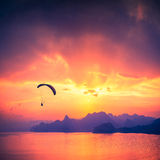 Paraglide silhouette over the sea sunset Royalty Free Stock Photo