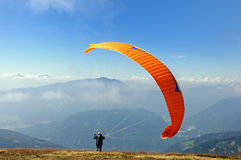 Paraglider. In starting phase in front of the mountains Stock Image