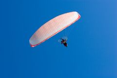 Paraglider. A Paraglider flies in the blue sky Royalty Free Stock Photo