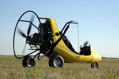 Paraglider. Grounded paraglider.  Motion blur from spinning propeller Royalty Free Stock Images