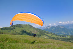 Paraglider. A starting paraglider (tandem) in the mountains of Austria. Image with copy space stock images