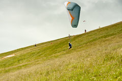 Paraglider. In flight about to take off a hillside Royalty Free Stock Image