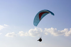 Paraglider. With cian wing in the sky stock images