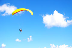 Paraglider. Yellow para-glide on a blue bright sky Stock Photo