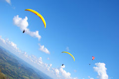 Paraglider. Many para-glides on a blue bright sky Stock Photography