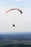 Paraglider. Paraglider floating over the sussex downs, England Stock Image