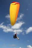 Paraglider. A woman in a yellow/red paraglider above the ocean (Reunion Island/Indic Ocean Stock Images