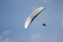 Paraglider. A para glider in the blue sky, seem like to start a wing-over Stock Image