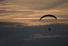 Paraglider. Flight on dark cloudy Stock Photos