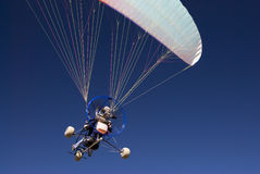 Paraglider. A powered paraglider in flight Royalty Free Stock Image