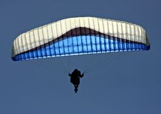 Paraglider. With blue and white sail Stock Photo