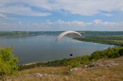 Paraglider above Bakota beautiful reservoir in the clouds Royalty Free Stock Images