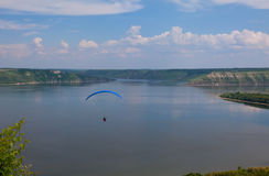 Paraglider above Bakota beautiful reservoir in the clouds Stock Image
