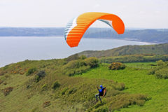 Paraglider above the coast Stock Photography