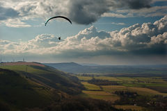 Paraglider above countryside landscape Royalty Free Stock Images