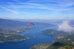 Paraglider above Lake Annecy Stock Images