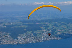 Paraglider above a lake Stock Images
