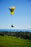 Paraglider above the Pacific Ocean. Paraglider flies over the coast of Santa Barbara, California with the Pacific Ocean in the background stock photo