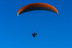 Paraglider against a blue sky Royalty Free Stock Photos