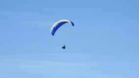 Paraglider in the air. With blue sky Stock Photography