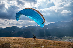 Paraglider on an alpine plateau Royalty Free Stock Image
