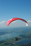 Paraglider in the Alps. Paraglider after a take-off from the top of Tegelberg Mountain in Schwangau, Bavaria Stock Images