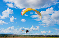 Paraglider in blue sky Stock Photography