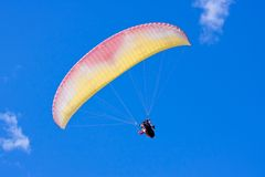 Paraglider in blue sky Royalty Free Stock Photography