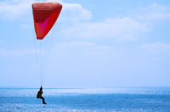 Paraglider on the blue sky. And sea Stock Photography