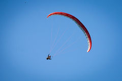 Paraglider in a blue sky. Paraglider, airborne in a clear blue sky Stock Images