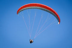 Paraglider in a blue sky. Paraglider, airborne in a clear blue sky Royalty Free Stock Photography