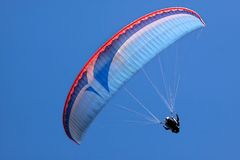 Paraglider in blue sky Stock Image